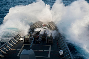 The bow of USS Cowpens plows through a wave in rough seas.の写真素材 [FYI02696309]