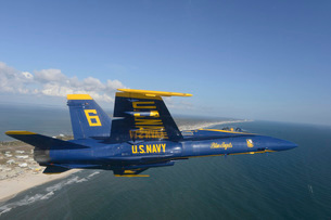 An F/A-18 Hornet from the Blue Angels flies a training sortie.の写真素材 [FYI02696877]