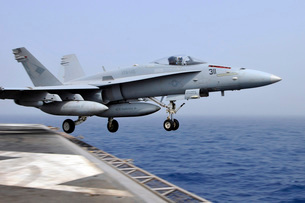 An F/A-18C Hornet catapults from the aircraft carrier USS Ronald Reagan.の写真素材 [FYI02696943]