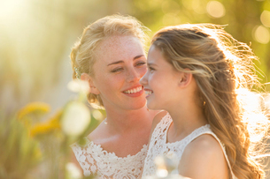 Bride talking to Bridesmaid in domestic gardenの写真素材 [FYI02698544]