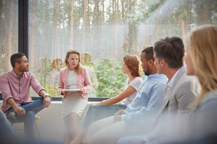 Therapist leading group therapy sessionの写真素材 [FYI02698683]