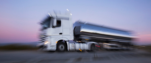Stainless steel milk tanker on the road at nightの写真素材 [FYI02699314]