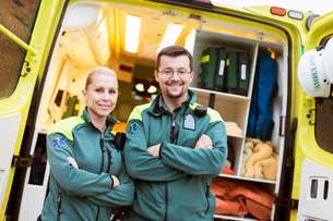 Sweden, Sodermanland, Tumba, Two paramedics next to ambulanceの写真素材 [FYI02699483]