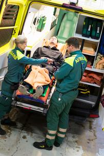 Sweden, Sodermanland, Tumba, Paramedics taking care of patientの写真素材 [FYI02699569]
