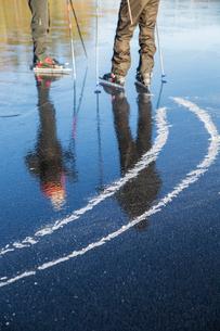 Sweden, Gastrikland, Edsken, Mature men ice skating on frozen lakeの写真素材 [FYI02699617]
