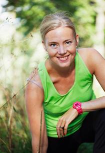Sweden, Sodermanland, Liljeholmen, Portrait of woman wearing tanktop and stopwatchの写真素材 [FYI02699636]
