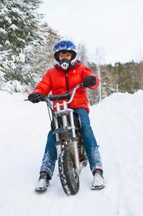 Sweden, Stockholm County, Dalaro, View of teenager on motorbの写真素材 [FYI02699840]