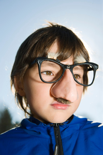 Finland, Kyrkslatt, Portrait of boy (6-7) in funny glassesの写真素材 [FYI02699932]