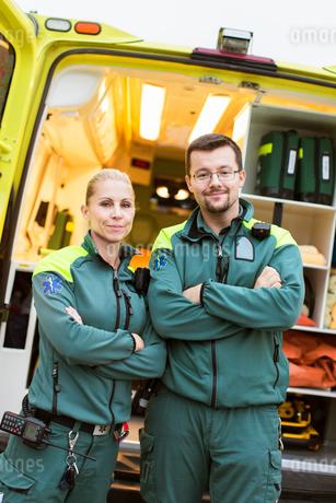 Sweden, Sodermanland, Tumba, Two paramedics next to ambulanceの写真素材 [FYI02700073]