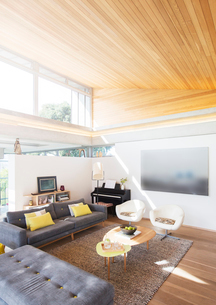 Slanted wood ceiling over living roomの写真素材 [FYI02700296]