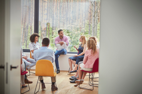Woman talking in group therapy sessionの写真素材 [FYI02700372]