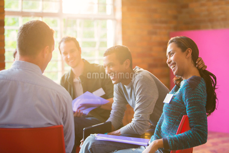 Smiling woman enjoying group therapy sessionの写真素材 [FYI02700430]