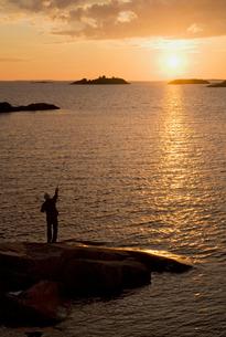 Finland, Turku archipelago, Silhouette of fishing manの写真素材 [FYI02700513]