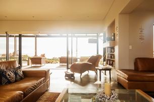 Sunny home showcase living room with open patio doorsの写真素材 [FYI02700721]