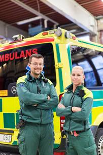 Sweden, Sodermanland, Tumba, Two paramedics next to ambulanceの写真素材 [FYI02700740]