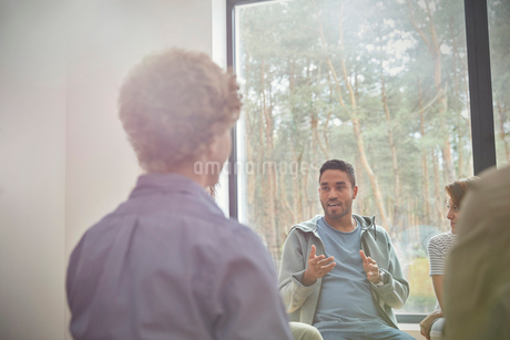 Man talking and gesturing in group therapy sessionの写真素材 [FYI02700848]