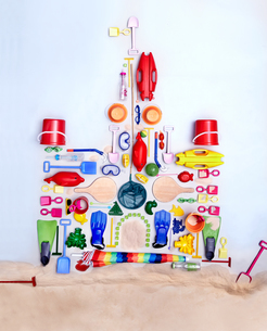 Still life concept beach toys forming sand castleの写真素材 [FYI02701854]