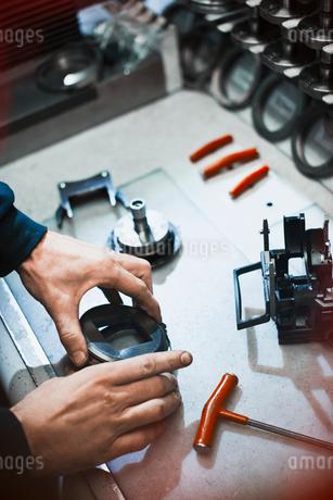 Worker examining part in steel factoryの写真素材 [FYI02702241]