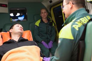 Sweden, Sodermanland, Tumba, Paramedics taking care of patientの写真素材 [FYI02702608]