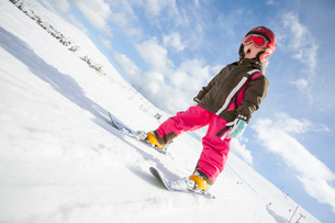 Norway, Osterdalen, Trysil, Girl (4-5) learning how to skiの写真素材 [FYI02702728]