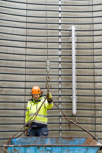 Sweden, Vastmanland, Construction worker standing inside water towerの写真素材 [FYI02703435]