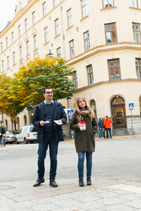 Sweden, Sodermanland, Stockholm, Sodermalm, Charity volunteers on streetの写真素材 [FYI02703754]