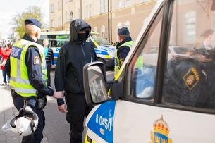 Sweden, Smaland, Jonkoping, Policemen arresting participant of demonstrationの写真素材 [FYI02703807]
