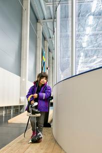 Sweden, Girl (6-7) standing by ice hockey rinkの写真素材 [FYI02703840]