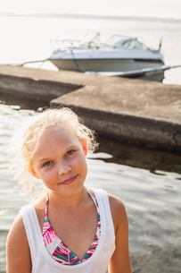 Sweden, Blekinge, Solvesborg, Portrait of blonde teenage girl (14-15) by cement jettyの写真素材 [FYI02703859]
