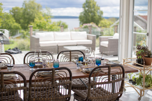 Sweden, Halland, Onsala, Dining room with terraceの写真素材 [FYI02704005]