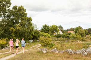 Sweden, Blekinge, Solvesbor, Torso, Teenage girls (14-15) walking on footpathの写真素材 [FYI02704112]