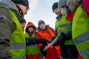 Sweden, Uppland, Upplands Vasby, Volunteers of Missing people organization discussing planの写真素材 [FYI02704242]
