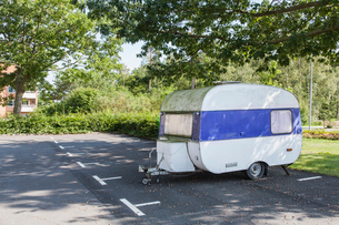 Sweden, Blekinge, Solvesborg, Camping trailer in parking spaceの写真素材 [FYI02704277]