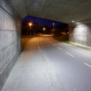 Sweden, Skane, Lund, Ideon Science Park, Illuminated road under bridgeの写真素材 [FYI02704342]