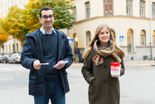 Sweden, Sodermanland, Stockholm, Sodermalm, Portrait of charity volunteers on streetの写真素材 [FYI02704359]