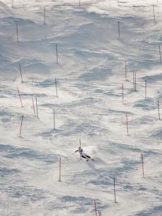 Sweden, Medelpad, Sundsvall, Skier going down slopeの写真素材 [FYI02704455]