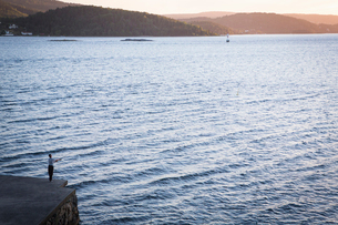 Norway, East Norway, Akershus, Drobak, Drobak Sound, Fishing at sunsetの写真素材 [FYI02704507]