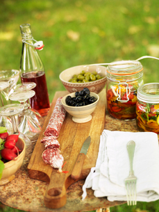Sweden, Vastergotland, Bottle of syrup and pickled vegetables on tableの写真素材 [FYI02704513]