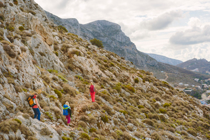 Greece, Dodecanese, Kalymnos, Hikers on mountainsideの写真素材 [FYI02704534]