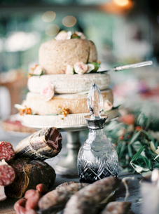 Italy, Cured meats, wine and Italian cheese on dining tableの写真素材 [FYI02704626]