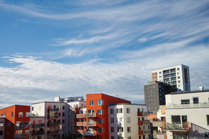 Sweden, Stockholm, Annedal, Cloudy sky over blocks of flatsの写真素材 [FYI02704653]