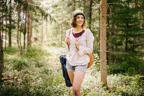 Sweden, Vasterbotten, Norrmjole, Young female hiker in forestの写真素材 [FYI02704694]