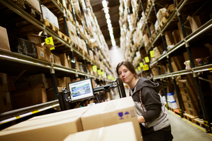 Sweden, Young woman working in warehouseの写真素材 [FYI02704750]