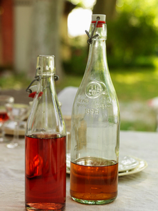Sweden, Vastergotland, Close up of bottles with syrupの写真素材 [FYI02704788]