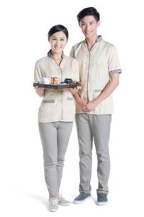 Massage therapists holding massage suppliesの写真素材 [FYI02704901]
