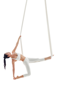Young Chinese woman practicing aerial yogaの写真素材 [FYI02705306]