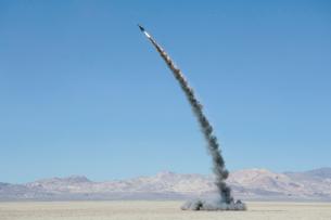 Rocket shooting into vast, desert sky, Black Rock Desert, Nevadaの写真素材 [FYI02705641]