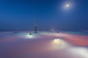 View of the Burj Khalifa and other skyscrapers above the clouds in Dubai, United Arab Emirates.の写真素材 [FYI02705648]
