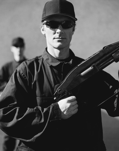 Men in special forces, holding high powered shotgun rifleの写真素材 [FYI02705659]