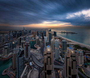 Cityscape of Dubai, United Arab Emirates at dusk, with skyscrapers lining coastline of the Persian Gの写真素材 [FYI02705664]